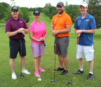 four-player golf team with clubs