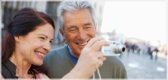 elderly couple taking a photo